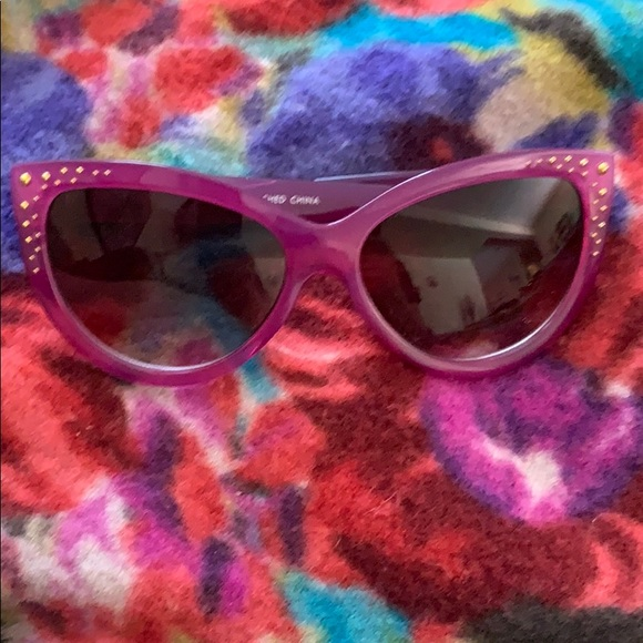 Cute pair of fuchsia sunglasses with gold studs
